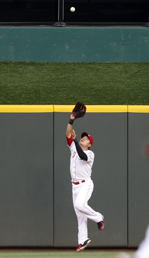 Aug 23, 2013; Cincinnati, OH, USA; Cincinnati Reds center fielder Shin-Soo Choo (17) makes a play during the second inning against the Milwaukee Brewers at Great American Ball Park. Mandatory Credit: Frank Victores-USA TODAY Sports