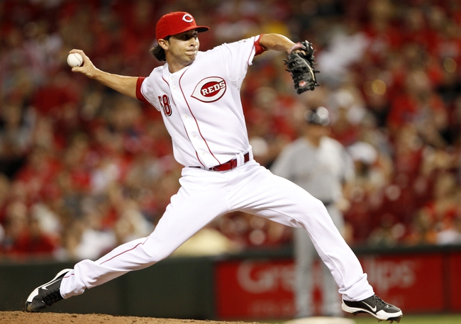 Aug 23, 2013; Cincinnati, OH, USA; Cincinnati Reds relief pitcher Nick Christiani (58) pitches during the eighth inning against the Milwaukee Brewers at Great American Ball Park. The Brewers defeated the Reds 6-4. Mandatory Credit: Frank Victores-USA TODAY Sports
