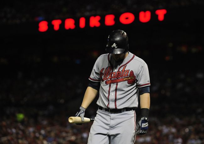 Aug 23, 2013; St. Louis, MO, USA; Atlanta Braves third baseman Chris Johnson (23) reacts after being struck out by St. Louis Cardinals starting pitcher Adam Wainwright (not pictured) during the fourth inning at Busch Stadium. St. Louis defeated Atlanta 3-1. Mandatory Credit: Jeff Curry-USA TODAY Sports
