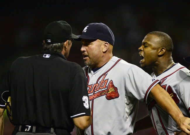 Aug 23, 2013; St. Louis, MO, USA; Atlanta Braves manager Fredi Gonzalez (center) holds back left fielder Justin Upton after he was ejected from the game by umpire Paul Nauert (39) during the sixth inning at Busch Stadium. St. Louis defeated Atlanta 3-1. Mandatory Credit: Jeff Curry-USA TODAY Sports