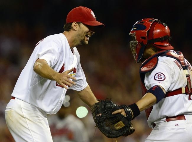 Aug 23, 2013; St. Louis, MO, USA; St. Louis Cardinals starting pitcher Adam Wainwright (50) celebrates with catcher Yadier Molina (4) after throwing a complete game against the Atlanta Braves at Busch Stadium. St. Louis defeated Atlanta 3-1. Mandatory Credit: Jeff Curry-USA TODAY Sports