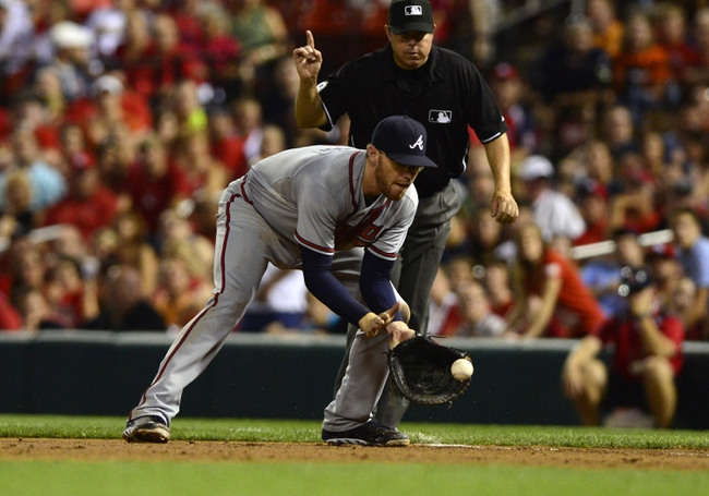 Aug 23, 2013; St. Louis, MO, USA; Atlanta Braves first baseman Freddie Freeman (5) fields a ground ball hit by St. Louis Cardinals second baseman Kolten Wong (not pictured) during the fifth inning at Busch Stadium. St. Louis defeated Atlanta 3-1. Mandatory Credit: Jeff Curry-USA TODAY Sports