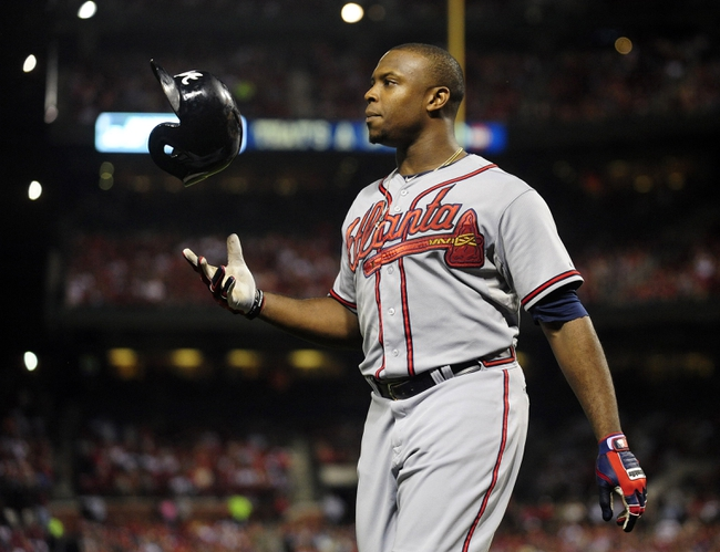 Aug 23, 2013; St. Louis, MO, USA; Atlanta Braves left fielder Justin Upton (8) tosses his helmet after being ejected from the game by umpire Paul Nauert (not pictured) during the sixth inning against the St. Louis Cardinals at Busch Stadium. St. Louis defeated Atlanta 3-1. Mandatory Credit: Jeff Curry-USA TODAY Sports