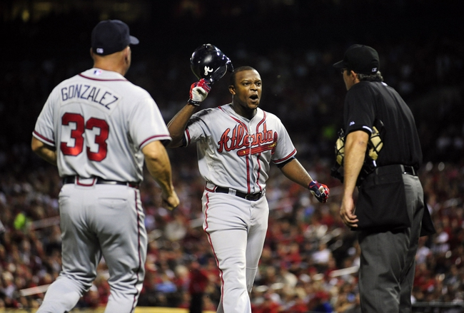 Aug 23, 2013; St. Louis, MO, USA; Atlanta Braves left fielder Justin Upton (8) is ejected from the game by umpire Paul Nauert (39) during the sixth inning against the St. Louis Cardinals at Busch Stadium. St. Louis defeated Atlanta 3-1. Mandatory Credit: Jeff Curry-USA TODAY Sports