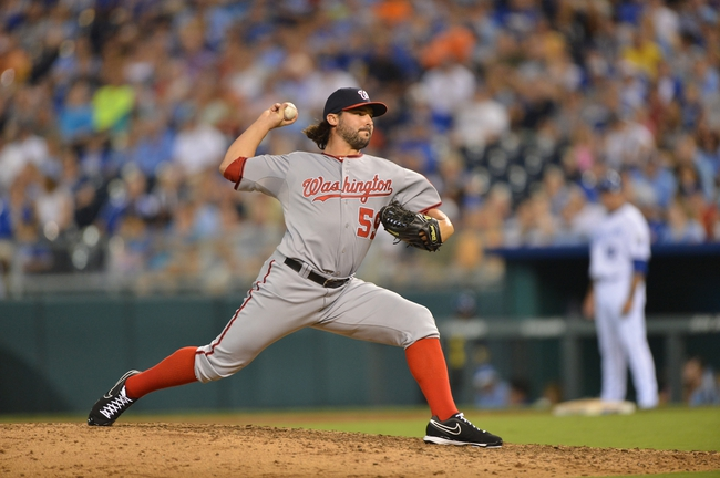 Aug 23, 2013; Kansas City, MO, USA; Washington Nationals pitcher Tanner Roark (59) delivers a pitch against the Kansas City Royals during the fourth inning at Kauffman Stadium.  Washington beat Kansas City 11-10. Mandatory Credit: Peter G. Aiken-USA TODAY Sports