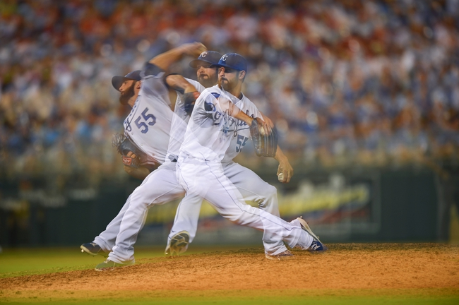 Aug 23, 2013; Kansas City, MO, USA; Multiple exposure of Kansas City Royals pitcher Tim Collins (55) delivers a pitch against the Washington Nationals  during the sixth inning at Kauffman Stadium.  Washington beat Kansas City 11-10. Credit: Peter G. Aiken-USA TODAY Sports