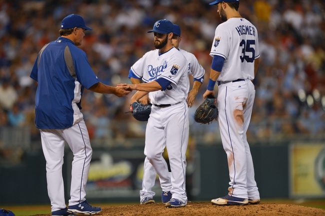 Aug 23, 2013; Kansas City, MO, USA; Kansas City Royals manager Ned Yost (left) takes pitcher Tim Collins (55) out of the game against the Washington Nationals during the sixth inning at Kauffman Stadium.  Washington beat Kansas City 11-10. Credit: Peter G. Aiken-USA TODAY Sports