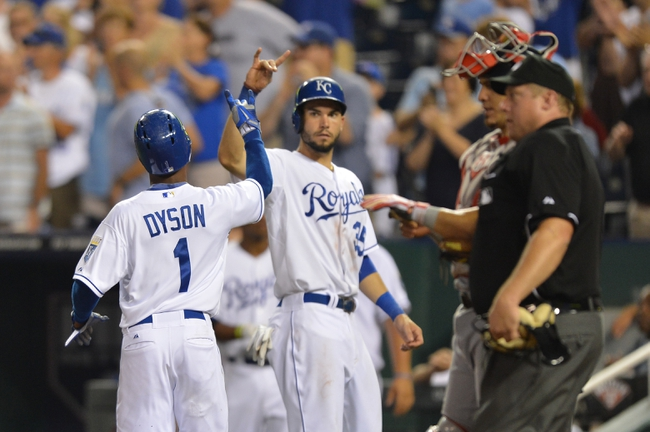 Aug 23, 2013; Kansas City, MO, USA; Kansas City Royals base runner Jarrod Dyson (1) celebrates after scoring with teammate Eric Hosmer (35) against the Washington Nationals during the ninth inning at Kauffman Stadium.  Washington beat Kansas City 11-10. Credit: Peter G. Aiken-USA TODAY Sports