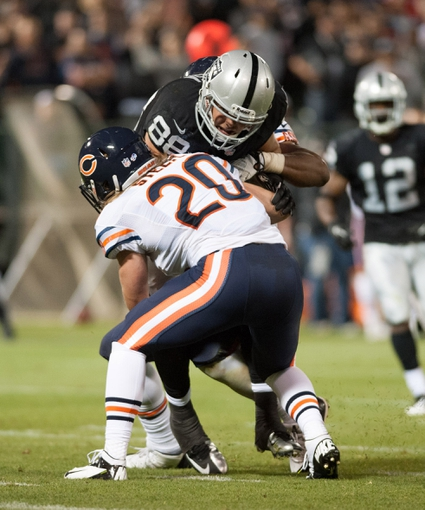 Aug 23, 2013; Oakland, CA, USA; Chicago Bears strong safety Craig Steltz (20) attempts to tackle Oakland Raiders tight end Nick Kasa (88) during the third quarter at O.Co Coliseum. The Chicago Bears defeated the Oakland Raiders 34-26. Mandatory Credit: Ed Szczepanski-USA TODAY Sports