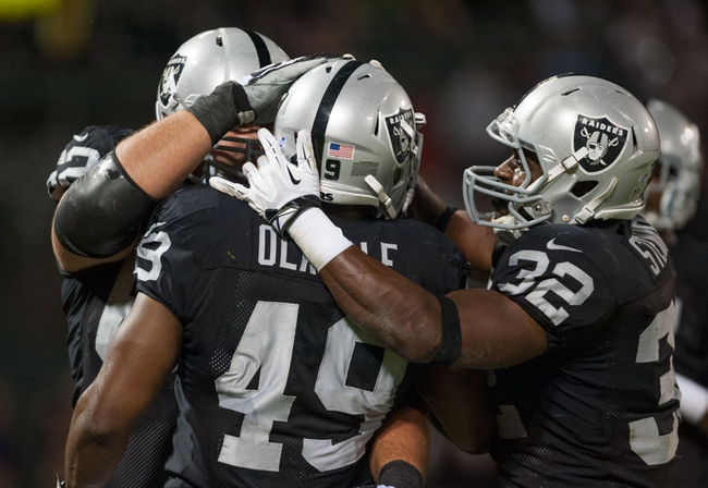 Aug 23, 2013; Oakland, CA, USA; Oakland Raiders running back Jamize Olawale (49) celebrates with team mates after scoring a touchdown against the Chicago Bears during the fourth quarter at O.Co Coliseum. The Chicago Bears defeated the Oakland Raiders 34-26. Mandatory Credit: Ed Szczepanski-USA TODAY Sports