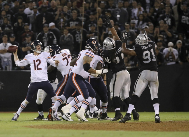 Aug 23, 2013; Oakland, CA, USA; Chicago Bears quarterback Josh McCown (12) passes the ball against the Oakland Raiders during the fourth quarter at O.co Coliseum. The Chicago Bears defeated the Oakland Raiders 34-26. Mandatory Credit: Kelley L Cox-USA TODAY Sports