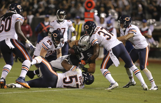 Aug 23, 2013; Oakland, CA, USA; Chicago Bears defense surround Oakland Raiders tight end Nick Kasa (88) as he scores a touchdown during the third quarter at O.co Coliseum. The Chicago Bears defeated the Oakland Raiders 34-26. Mandatory Credit: Kelley L Cox-USA TODAY Sports