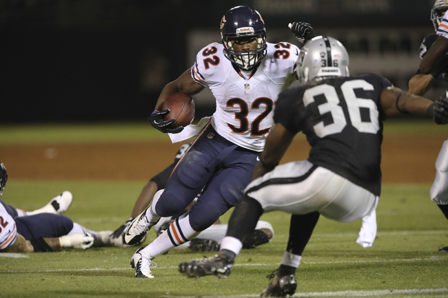 Aug 23, 2013; Oakland, CA, USA; Chicago Bears running back Michael Ford (32) carries the ball for a touchdown against Oakland Raiders defensive back Reggie Smith (36) during the fourth quarter at O.co Coliseum. The Chicago Bears defeated the Oakland Raiders 34-26. Mandatory Credit: Kelley L Cox-USA TODAY Sports