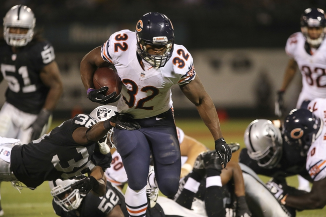 Aug 23, 2013; Oakland, CA, USA; Chicago Bears running back Michael Ford (32) escapes the Oakland Raiders tackles for a touchdown during the fourth quarter at O.co Coliseum. The Chicago Bears defeated the Oakland Raiders 34-26. Mandatory Credit: Kelley L Cox-USA TODAY Sports