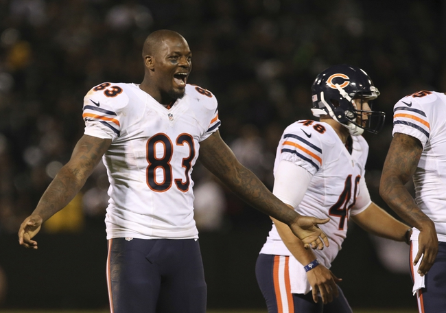 Aug 23, 2013; Oakland, CA, USA; Chicago Bears tight end Martellus Bennett (83) waits to celebrate with teammates from the sideline after a touchdown against the Oakland Raiders during the fourth quarter at O.co Coliseum. The Chicago Bears defeated the Oakland Raiders 34-26. Mandatory Credit: Kelley L Cox-USA TODAY Sports