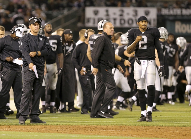 Aug 23, 2013; Oakland, CA, USA; Oakland Raiders head coach Dennis Allen on the sideline during the fourth quarter against the Chicago Bears at O.co Coliseum. The Chicago Bears defeated the Oakland Raiders 34-26. Mandatory Credit: Kelley L Cox-USA TODAY Sports