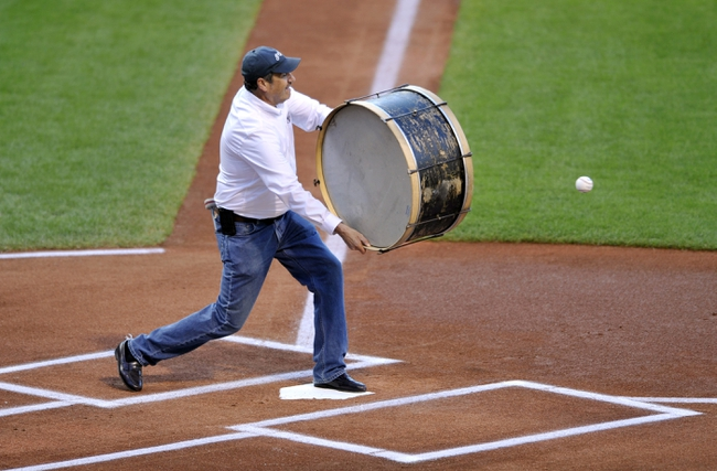 Aug 24, 2013; Cleveland, OH, USA; Cleveland Indians fan John Adams aims his drum at a ceremonial first pitch thrown by former player Carlos Baerga (not pictured) before a game against the Minnesota Twins at Progressive Field. Mandatory Credit: David Richard-USA TODAY Sports