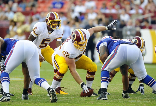 Aug 24, 2013; Landover, MD, USA; Washington Redskins quarterback Pat White (5) prepares to take the snap from Washington Redskins center Kevin Matthews (72) during the second half against the Buffalo Bills at FedEX Field. Mandatory Credit: Brad Mills-USA TODAY Sports