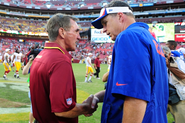 Aug 24, 2013; Landover, MD, USA; Washington Redskins head coach Mike Shanahan (left) shakes hands with Buffalo Bills head coach Doug Marrone (right) after the game at FedEx Field. Mandatory Credit: Evan Habeeb-USA TODAY Sports
