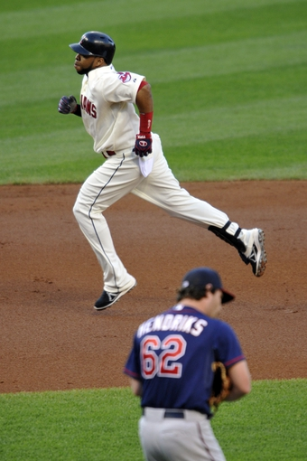 Aug 24, 2013; Cleveland, OH, USA; Cleveland Indians designated hitter Carlos Santana (41) rounds the bases after hitting a two-run home run off of Minnesota Twins starting pitcher Liam Hendriks (62) in the first inning at Progressive Field. Mandatory Credit: David Richard-USA TODAY Sports