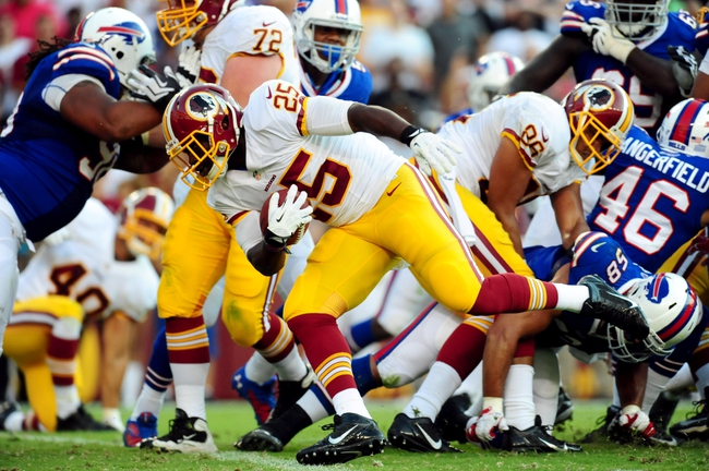 Aug 24, 2013; Landover, MD, USA; Washington Redskins running back Keiland Williams (25) scores a 1 yard touchdown in the fourth quarter against the Buffalo Bills at FedEx Field. Mandatory Credit: Evan Habeeb-USA TODAY Sports