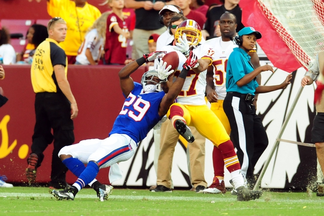 Aug 24, 2013; Landover, MD, USA; Buffalo Bills cornerback Crezdon Butler (29) knocks a pass away from Washington Redskins wide receiver Chip Reeves (17) at FedEx Field. Mandatory Credit: Evan Habeeb-USA TODAY Sports