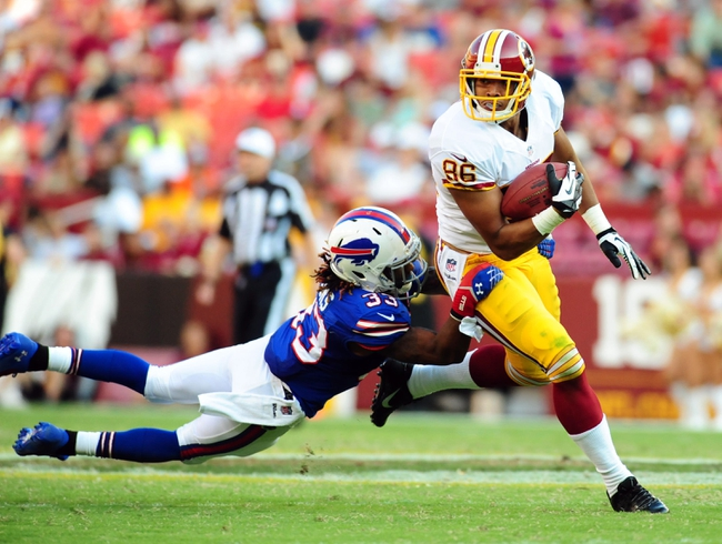 Aug 24, 2013; Landover, MD, USA; Washington Redskins tight end Jordan Reed (86) gets tackled by Buffalo Bills cornerback Ron Brooks (33) at FedEx Field. Mandatory Credit: Evan Habeeb-USA TODAY Sports