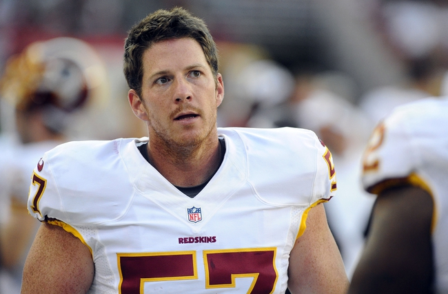 Aug 24, 2013; Landover, MD, USA; Washington Redskins long snapper Nick Sundberg (57) on the sidelines during the second half against the Buffalo Bills at FedEX Field. Mandatory Credit: Brad Mills-USA TODAY Sports