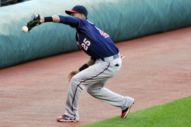 Aug 24, 2013; Cleveland, OH, USA; Minnesota Twins shortstop Pedro Florimon (25) drops a foul ball in the first inning against the Cleveland Indians at Progressive Field. Florimon was charged with an error. Mandatory Credit: David Richard-USA TODAY Sports