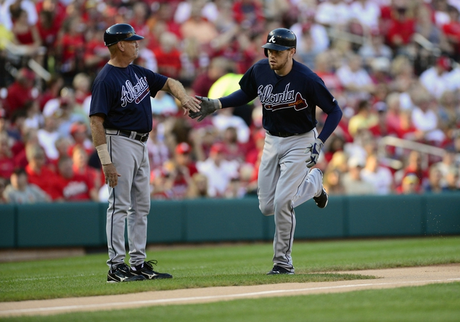 Aug 24, 2013; St. Louis, MO, USA; Atlanta Braves first baseman Freddie Freeman (right) is congratulated by third base coach Brian Snitker (51) after hitting a solo home run off of St. Louis Cardinals starting pitcher Shelby Miller (not pictured) during the first inning at Busch Stadium. Mandatory Credit: Jeff Curry-USA TODAY Sports