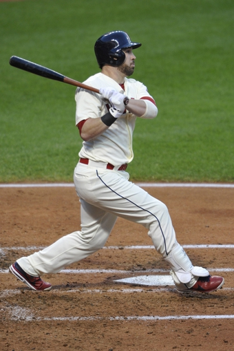 Aug 24, 2013; Cleveland, OH, USA; Cleveland Indians second baseman Jason Kipnis (22) hits a two-run home run in the third inning against the Minnesota Twins at Progressive Field. Mandatory Credit: David Richard-USA TODAY Sports