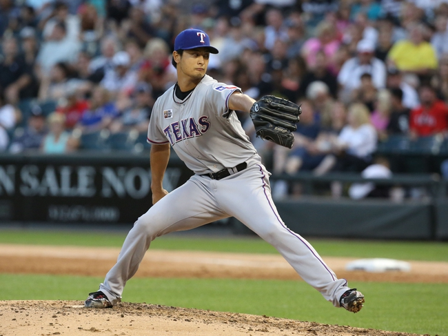 Aug 24, 2013; Chicago, IL, USA; Texas Rangers starting pitcher Yu Darvish (11) throws a pitch during the third inning against the Chicago White Sox at US Cellular Field. Mandatory Credit: Dennis Wierzbicki-USA TODAY Sports