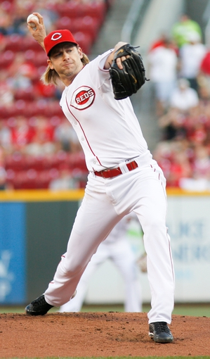 Aug 24, 2013; Cincinnati, OH, USA; Cincinnati Reds starting pitcher Bronson Arroyo (61) throws against the Milwaukee Brewers in the first inning at Great American Ball Park. Mandatory Credit: David Kohl-USA TODAY Sports