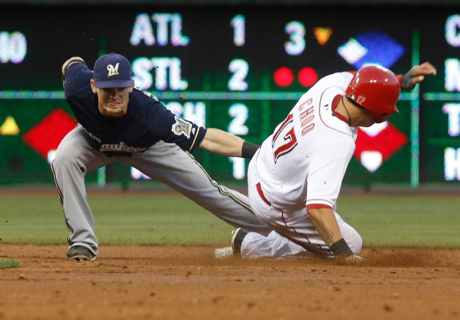 Aug 24, 2013; Cincinnati, OH, USA; Cincinnati Reds center fielder Shin-Soo Choo (17) is tagged out by Milwaukee Brewers shortstop Jean Segura (9) after Choo was caught stealing second in the third inning at Great American Ball Park. Mandatory Credit: David Kohl-USA TODAY Sports