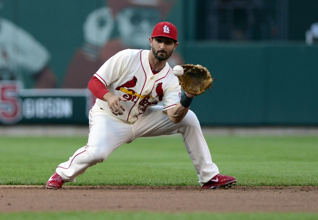 Aug 24, 2013; St. Louis, MO, USA; St. Louis Cardinals second baseman Daniel Descalso (33) fields a ground ball hit by Atlanta Braves shortstop Andrelton Simmons (not pictured) during the second inning at Busch Stadium. Mandatory Credit: Jeff Curry-USA TODAY Sports