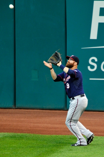 Aug 24, 2013; Cleveland, OH, USA; Minnesota Twins right fielder Ryan Doumit (9) makes a catch in the third inning against the Cleveland Indians at Progressive Field. Mandatory Credit: David Richard-USA TODAY Sports