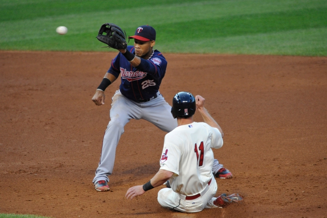 Aug 24, 2013; Cleveland, OH, USA; Cleveland Indians right fielder Drew Stubbs (11) steals second base under the tag of Minnesota Twins shortstop Pedro Florimon (25) in the third inning at Progressive Field. Mandatory Credit: David Richard-USA TODAY Sports
