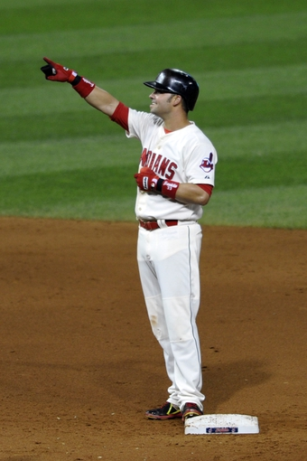Aug 24, 2013; Cleveland, OH, USA; Cleveland Indians first baseman Nick Swisher (33) celebrates his two-RBI double in the fifth inning against the Minnesota Twins at Progressive Field. Mandatory Credit: David Richard-USA TODAY Sports