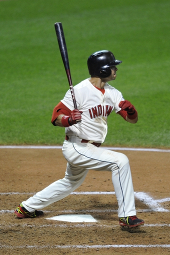 Aug 24, 2013; Cleveland, OH, USA; Cleveland Indians first baseman Nick Swisher (33) hits a two-RBI double in the fifth inning against the Minnesota Twins at Progressive Field. Mandatory Credit: David Richard-USA TODAY Sports