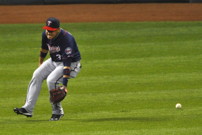 Aug 24, 2013; Cleveland, OH, USA; Minnesota Twins left fielder Oswaldo Arcia (31) overruns an RBI single by Cleveland Indians left fielder Michael Brantley (not pictured) in the fifth inning at Progressive Field. Mandatory Credit: David Richard-USA TODAY Sports