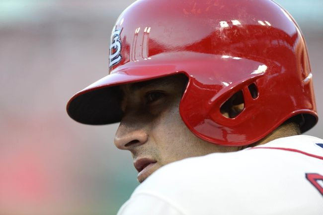 Aug 24, 2013; St. Louis, MO, USA; St. Louis Cardinals first baseman Allen Craig (21) looks on during the third inning against the Atlanta Braves at Busch Stadium. Mandatory Credit: Jeff Curry-USA TODAY Sports