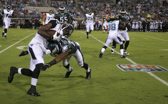 Aug 24, 2013; Jacksonville, FL, USA; Jacksonville Jaguars wide receiver Justin Blackmon (14) is hit by Philadelphia Eagles cornerback Bradley Fletcher (24) after catching a screen pass  during the second quarter of their game at EverBank Field. Mandatory Credit: Phil Sears-USA TODAY Sports