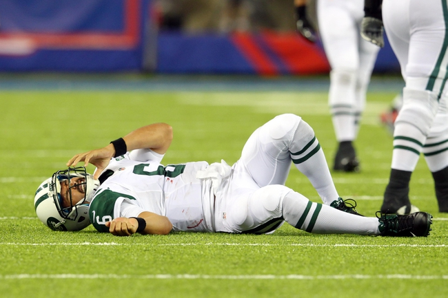 Aug 24, 2013; East Rutherford, NJ, USA; New York Jets quarterback Mark Sanchez (6) lies injured on the field after taking a hit from New York Giants linebacker Mark Herzlich (not pictured) during the fourth quarter of a preseason game at MetLife Stadium. Mandatory Credit: Brad Penner-USA TODAY Sports