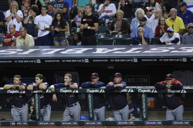 Aug 24, 2013; Cleveland, OH, USA; Minnesota Twins manager Ron Gardenhire (right) and his team watch in the ninth inning against the Cleveland Indians at Progressive Field. Mandatory Credit: David Richard-USA TODAY Sports