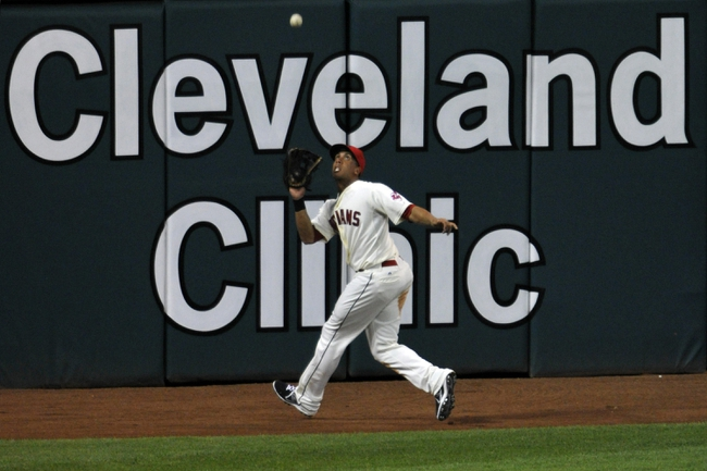 Aug 24, 2013; Cleveland, OH, USA; Cleveland Indians left fielder Michael Brantley (23) catches a fly ball in the eighth inning against the Minnesota Twins at Progressive Field. Mandatory Credit: David Richard-USA TODAY Sports
