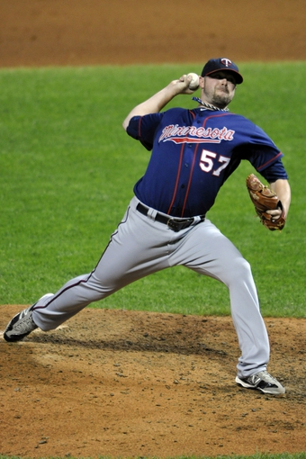 Aug 24, 2013; Cleveland, OH, USA; Minnesota Twins relief pitcher Ryan Pressly (57) delivers in the eighth inning against the Cleveland Indians at Progressive Field. Mandatory Credit: David Richard-USA TODAY Sports