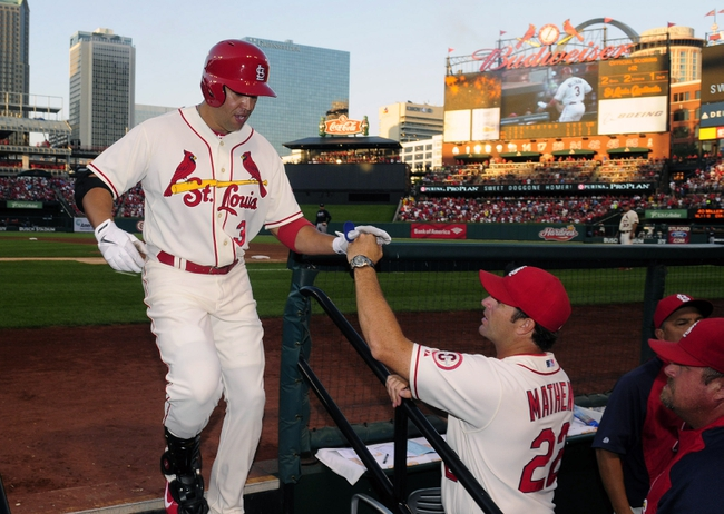 Aug 24, 2013; St. Louis, MO, USA; St. Louis Cardinals right fielder Carlos Beltran (3) is congratulated by manager Mike Matheny (22) after hitting a solo home run off of Atlanta Braves starting pitcher Julio Teheran (not pictured) during the third inning at Busch Stadium. St. Louis defeated Atlanta 6-2. Mandatory Credit: Jeff Curry-USA TODAY Sports