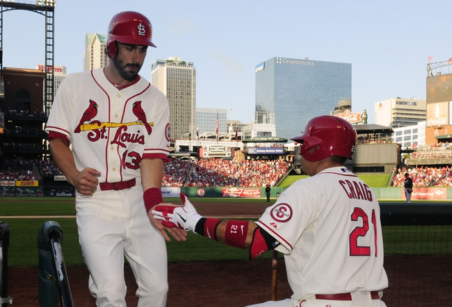 Aug 24, 2013; St. Louis, MO, USA; St. Louis Cardinals third baseman Matt Carpenter (13) is congratulated by first baseman Allen Craig (21) after hitting a solo home run off of Atlanta Braves starting pitcher Julio Teheran (not pictured) during the first inning at Busch Stadium. St. Louis defeated Atlanta 6-2. Mandatory Credit: Jeff Curry-USA TODAY Sports