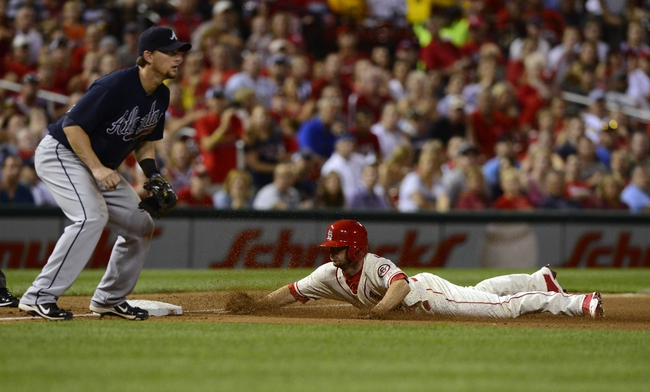 Aug 24, 2013; St. Louis, MO, USA; St. Louis Cardinals right fielder Shane Robinson (43) slides safely into third on a single by second baseman Matt Carpenter (not pictured) during the seventh inning against the Atlanta Braves at Busch Stadium. St. Louis defeated Atlanta 6-2. Mandatory Credit: Jeff Curry-USA TODAY Sports
