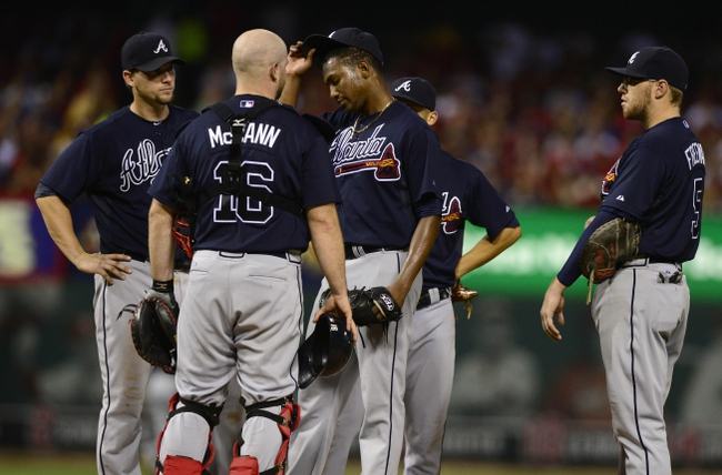 Aug 24, 2013; St. Louis, MO, USA; Atlanta Braves starting pitcher Julio Teheran (49) is removed from the game during the seventh inning against the St. Louis Cardinals at Busch Stadium. St. Louis defeated Atlanta 6-2. Mandatory Credit: Jeff Curry-USA TODAY Sports